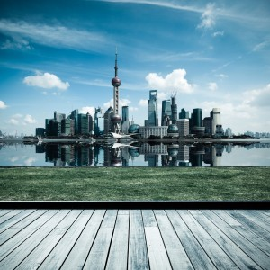 ! china_shanghai skyline with reflection and wooden floor and lawn